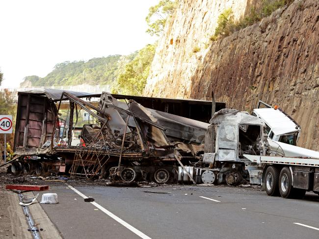 A FIERY crash between a B-double truck and a mobile crane is blocking all northbound lanes on the M1 Pacific Motorway at Brooklyn, north of Sydney.