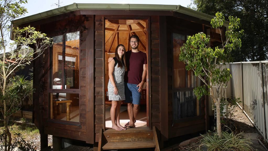 Andrew Wise and Jen Brissenden show off their backyard yurt in Newcastle.