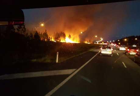 Traffic backs up on the Bruce Hwy as a blaze burns bushland near Roy's Rd.