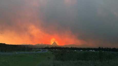 The bushfire burns around Glasshouse Mountains.