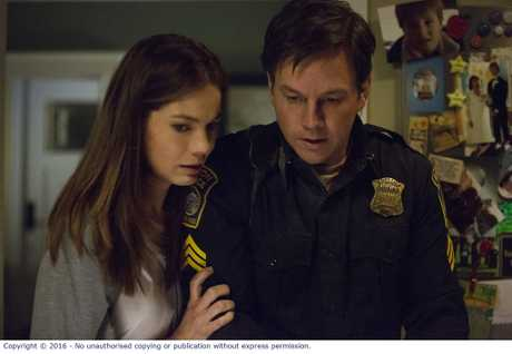 Michelle Monaghan and Mark Wahlberg in a scene from the movie Patriots Day.