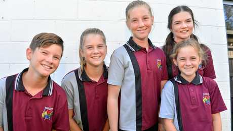 Jett, 12, Dylan 13, Tamzyn 12, Paige 13 and Arcia King, 16 recreating their first day of primary school as they set off for high school.