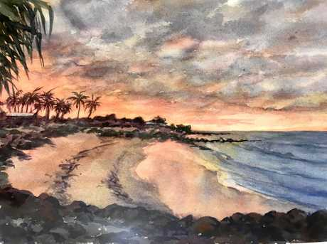 Beautiful orange hues over the beach, by Mary Argall.