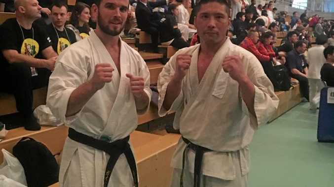 RESPECT: Guy Thrupp in Okinawa with his second-round opponent at the Kyokushin World Karate Championships.