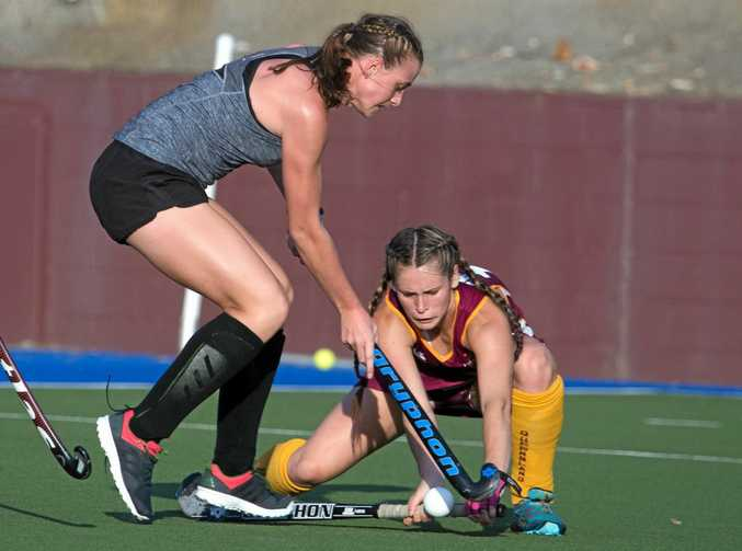 IN THE THICK OF IT: Queensland player Jade Emblem tackles Canada's Sam McRory.