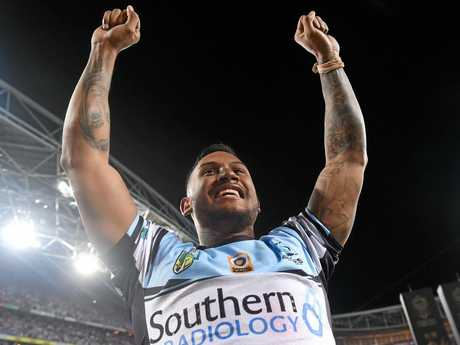 Ben Barba of the Sharks celebrates their win during the NRL Grand Final between the Melbourne Storm and the Cronulla-Sutherland Sharks at ANZ Stadium in Sydney, Sunday, Oct. 2, 2016. (AAP Image/Paul Miller) NO ARCHIVING, EDITORIAL USE ONLY