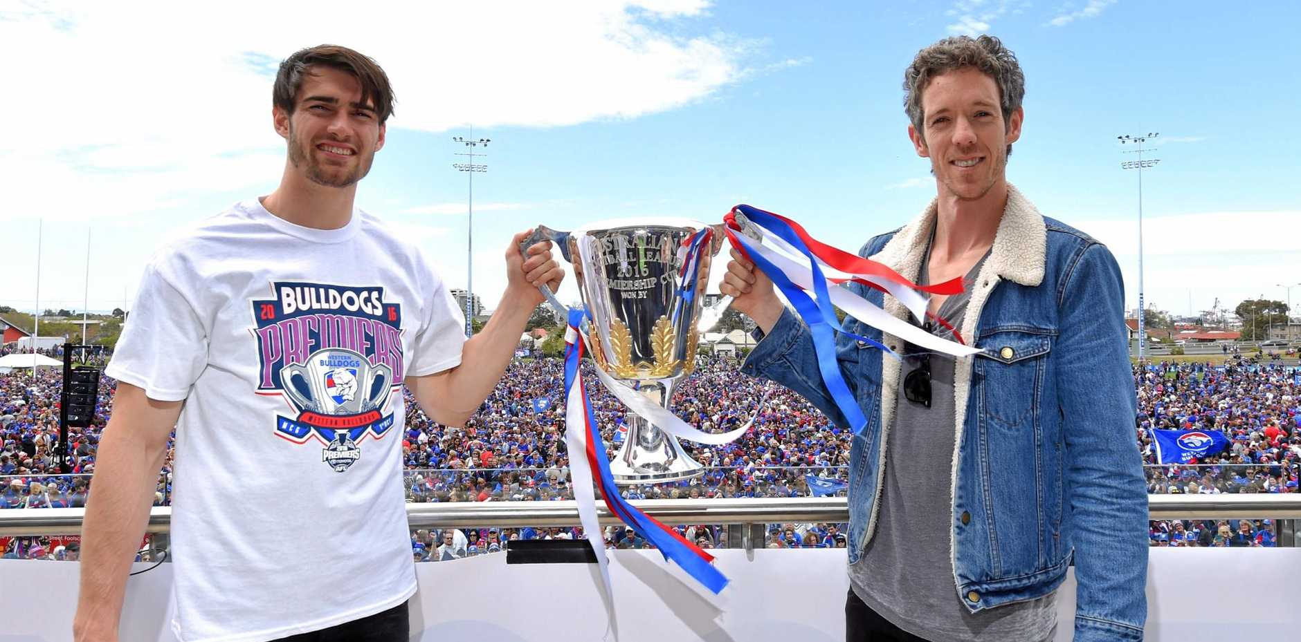 Western Bulldogs captains Robert Murphy (right) with stand-in skipper Easton Wood and the 2016 premiership trophy at Whitten Oval.