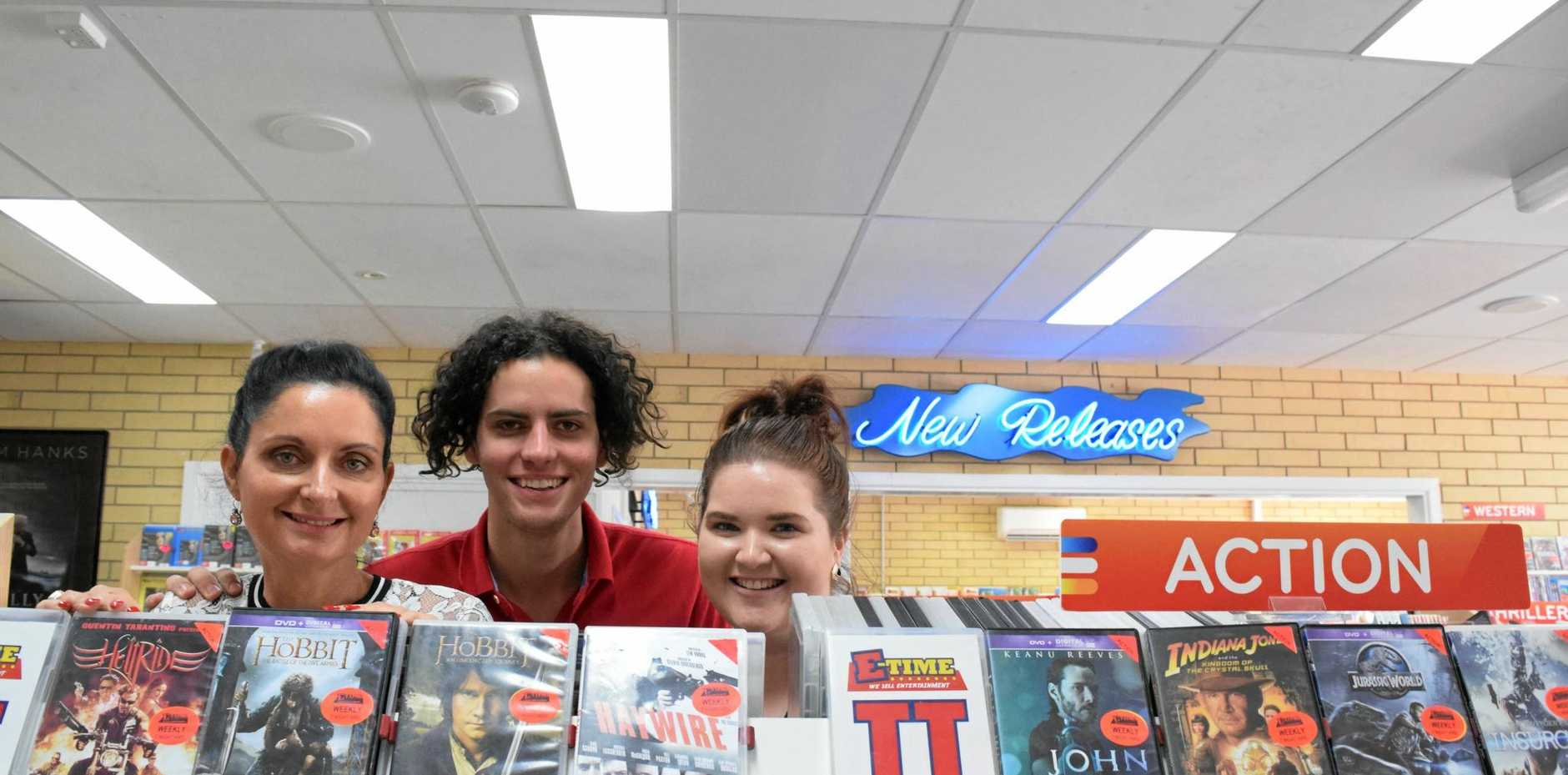 CLASSICS: Karen and Hayden Ford and Kate Stallan at E-Time, soon to be the last video store in Bundaberg.