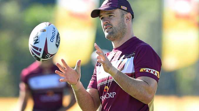 Sea Eagles forward Nate Myles receives the ball during a Maroons State of Origin team training session.