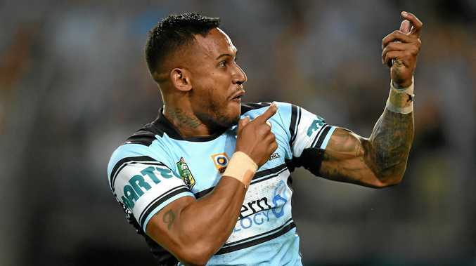 Ben Barba of the Sharks celebrates with teammates after scoring a try during the 2016 NRL grand final.