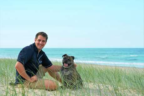 Beachside Vet at Coolum's Dr Daniel Capps with his dog, Kevin.