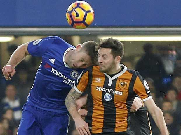 Chelsea's Gary Cahill, left, and Hull City's Ryan Mason clash heads.