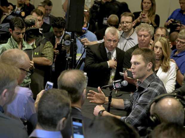 New England Patriots quarterback Tom Brady talks to the media.
