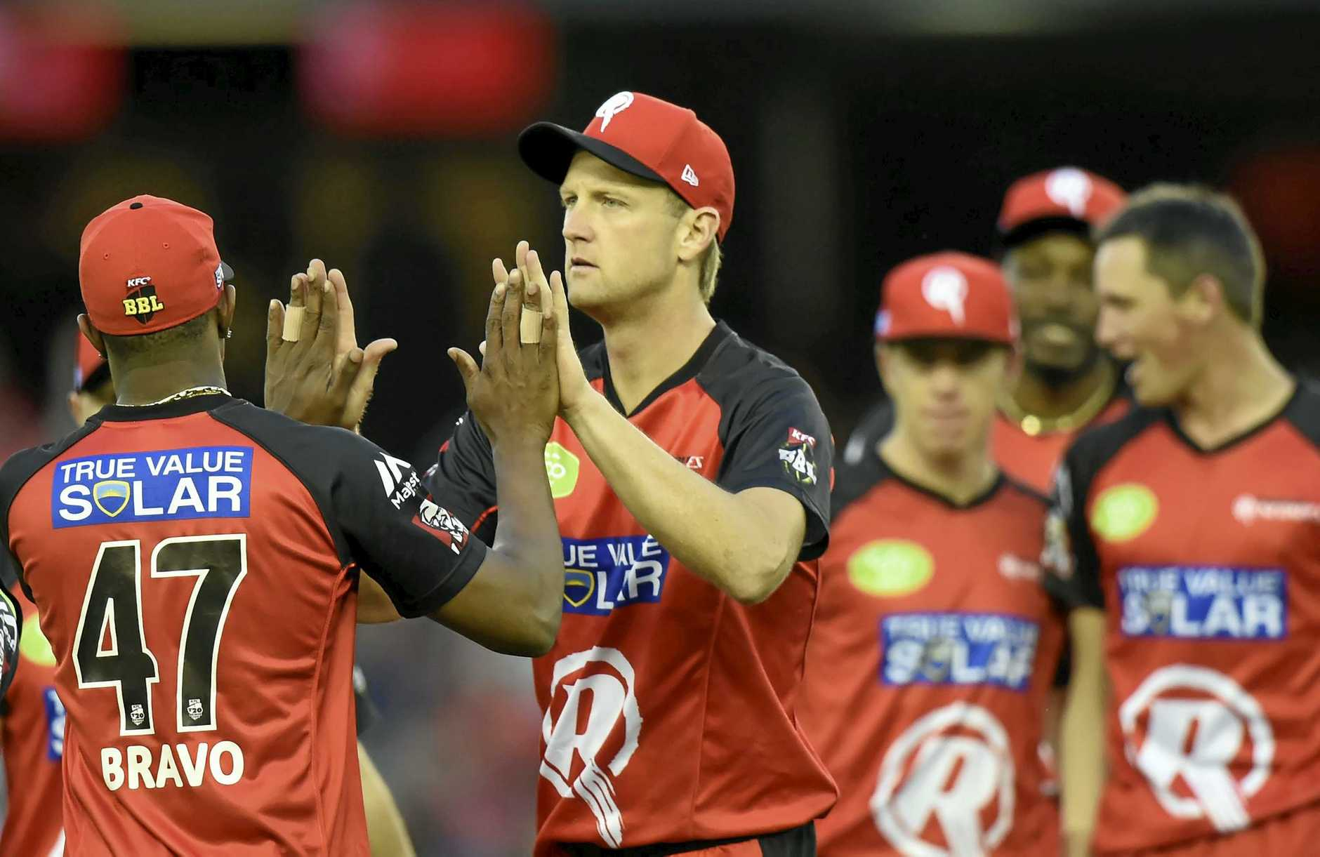 Dwayne Bravo is congratulated by Cameron White on taking a catch for the Melbourne Renegades in the Big Bash League.