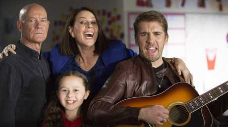 Gary Sweet, Julia Morris, Madison Torres and Hugh Sheridan in a scene from House Husbands.