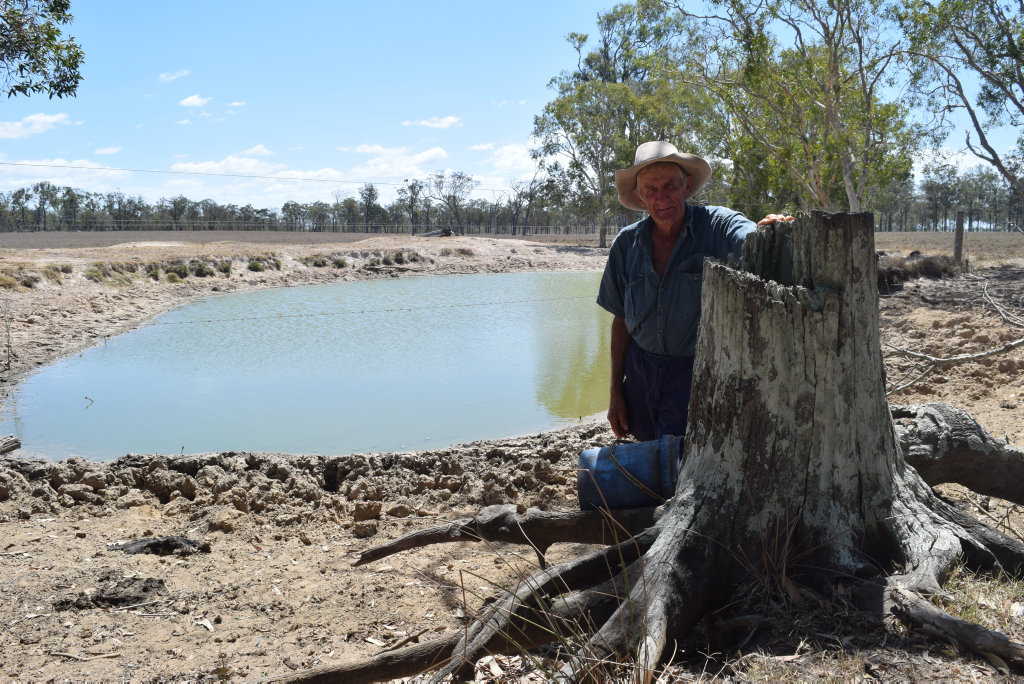 THE LAST DROP: Surrounded by a growing dust bowl, Beaver Rock grazier Royce Sommerfeld stands in front of the last few litres of stagnate water in his dam.