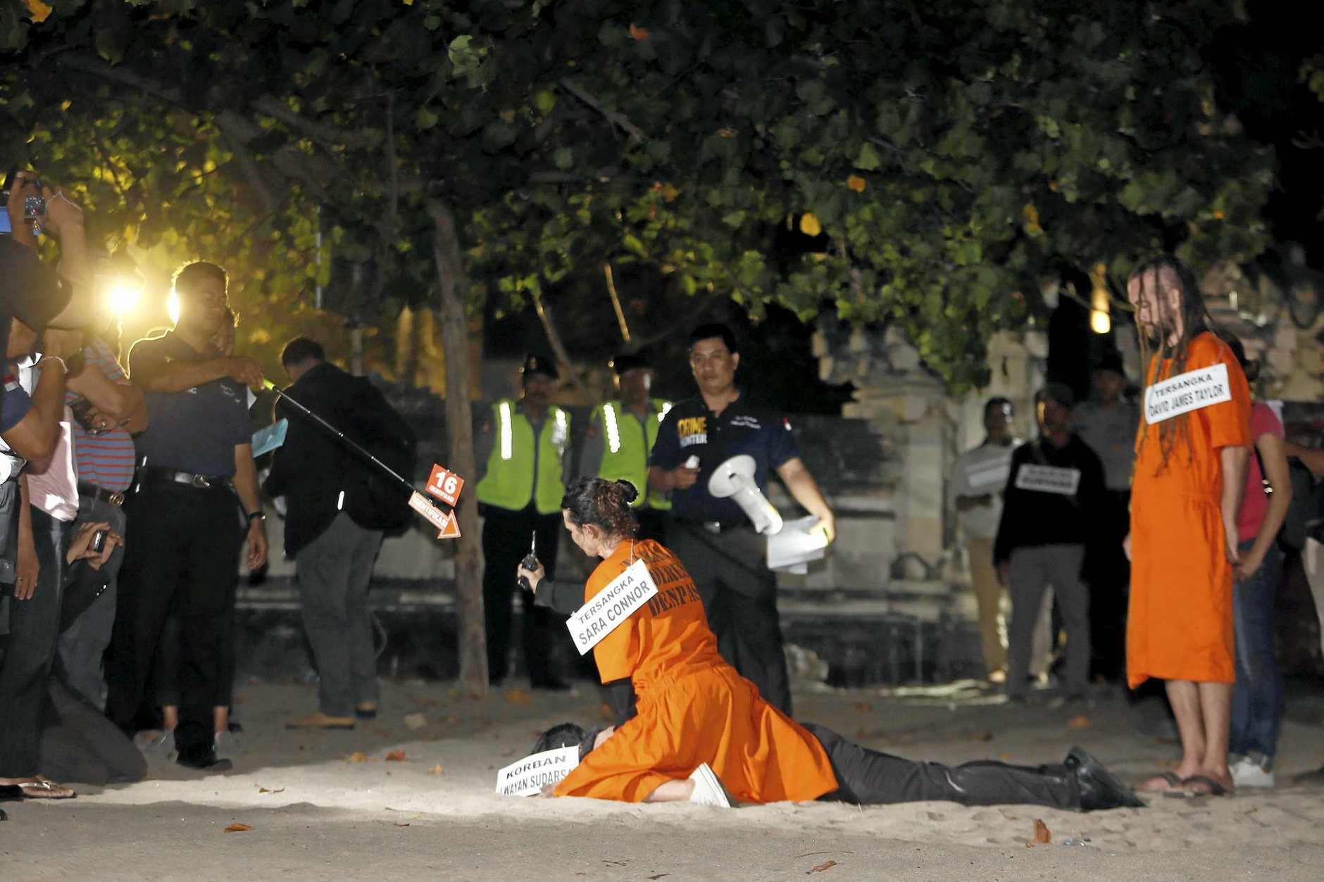 epa05516075 Australian national Sara Connor (C) and British national David Taylor (R)participate in the reconstruction of the death of a police officer at Kuta beach in Bali, Indonesia, 31 August 2016. Australian Sara Connor and British national David Taylor, were arrested by Bali police, and are accused of murdering a local policeman on Kuta Beach. The body of police officer Wayan Sudarsa was found with deep wounds to his head and neck on Kuta beach on 17 August 2016.  EPA/MADE NAGI