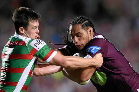 Martin Taupau (right) of the Sea Eagles is tackled by Luke Keary of the Rabbitohs