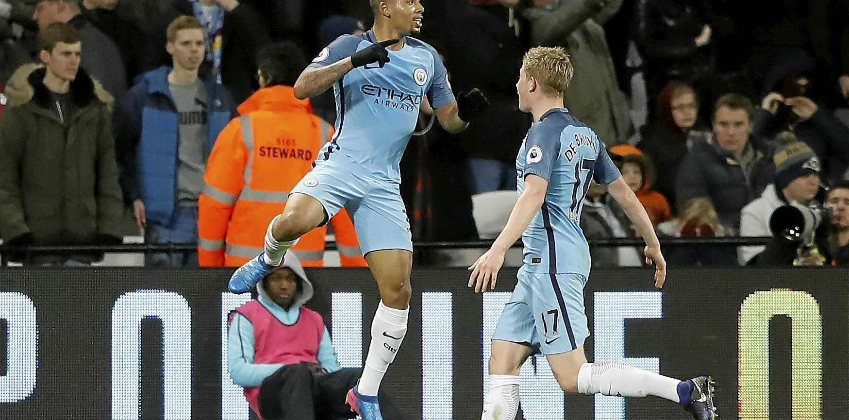 Manchester City's Gabriel Jesus, left, celebrates scoring one of his team's four goals against West Ham.