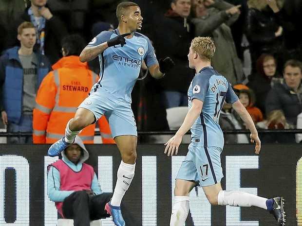 Manchester City's Gabriel Jesus, left, celebrates scoring one of his team's four goals against West Ham.