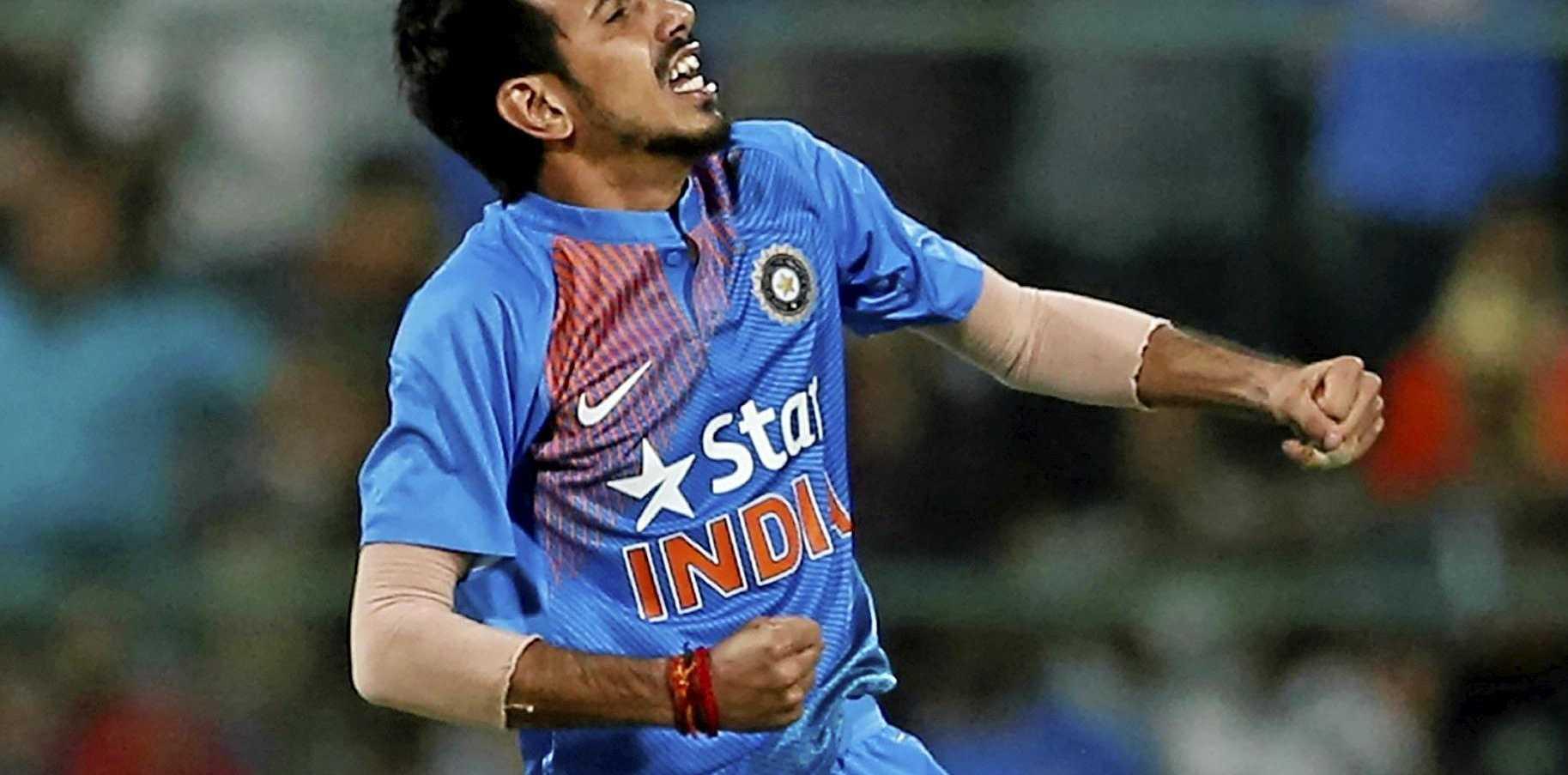 India's Yuzvendra Chahal celebrates the dismissal of England's Joe Root.