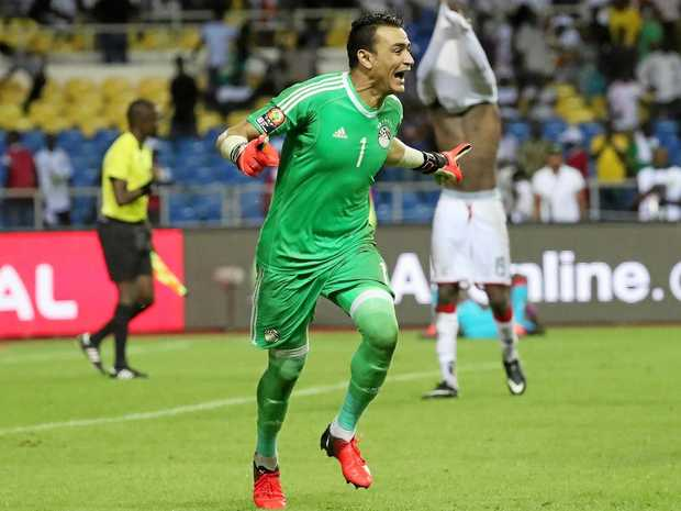 Essam El Hadary of Egypt celebrates after saving Bertrand Traore's penalty to win the Africa Cup of Nations semi-final.