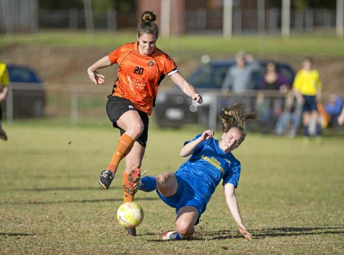 CRUNCH: Tegan Riding of Eastern Suburbs is tackled by South-West Thunder's Madison Franke.