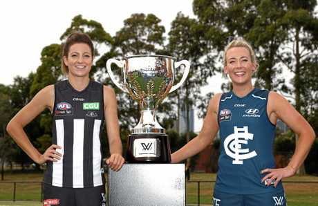 Steph Chiocci of the Magpies and Lauren Arnell of the Blues pose for a photograph during the 2017 AFL Women's competition launch at Laurens Hall