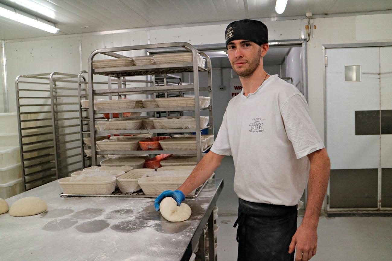 Baker Cameron Duff prepares some dough.