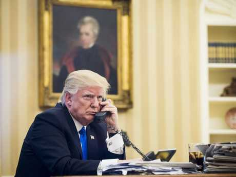 US President Donald J. Trump speaks on the phone with Prime Minister of Australia, Malcolm Turnbull, in the Oval Office in Washington, DC, USA, 28 January 2017. The call was one of five calls with foreign leaders scheduled for 28 January.