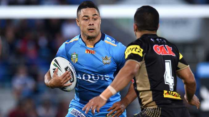Jarryd Hayne of the Gold Coast Titans (left) faces Tyrone Peachey of the Penrith Panthers during their round 25 NRL game at Cbus Super Stadium on the Gold Coast, Saturday, Aug. 27, 2016. (AAP Image/Dan Peled) NO ARCHIVING, EDITORIAL USE ONLY