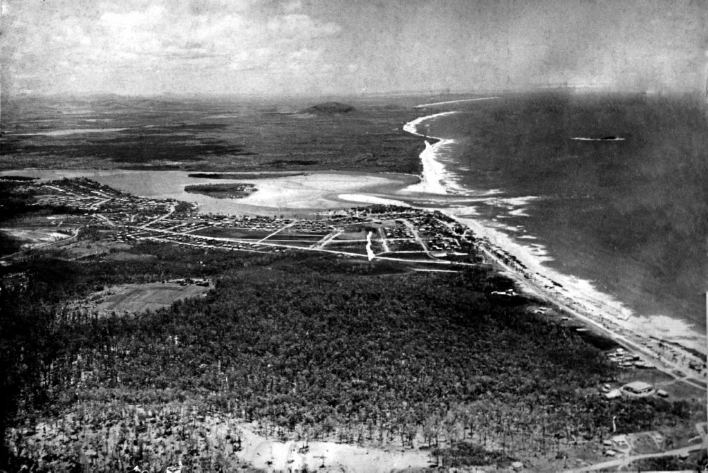26/06/09 183427Aerial view along the coast from Maroochydore, ca 1950. Cotton Tree and the Maroochy River mouth in middle distance, Mount Coolum in background, Mudjimba Island far right. Note the large area of undeveloped country on the North Shore, where the initial phase of urbanisation took-off in the 1950s.Old historical photo. M839200Carol Hawley Heritage Library Assistant (Nambour) Sunshine Coast Libraries