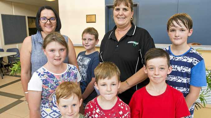 GOOD CAUSE: Celebrating the donation from the children are (back, from left) Jodie Collins, Joe Harold, Debbie Kearney, Callum Butler (front, from left) Ambrose Fisk, Damien James, Max Butler and Jack Pearson.