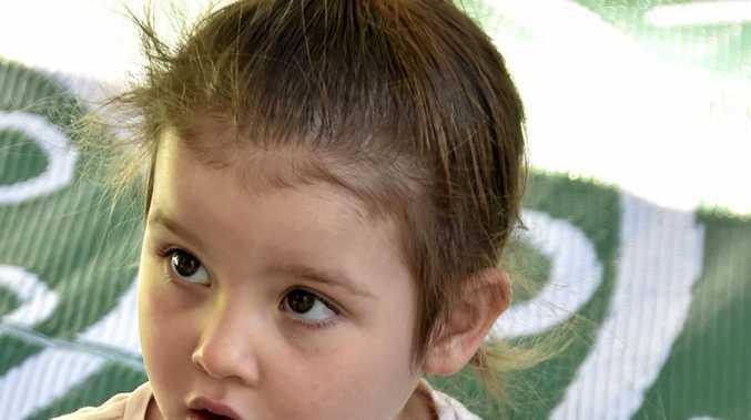 Georgia Kelly, 3, listens intently.