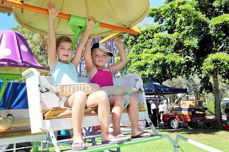 Sisters Ayana (7) and Izzy (5) Walsh of Coolum Beach enjoy a ride on the Mini Ferris Wheel at the Pier Park Community Markets on Saturday while holidaying at Urangan. Photo: Jocelyn Watts / Fraser Coast Chronicle