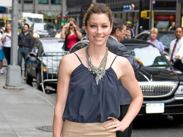 Actress Jessica Biel shows off a pencil skirt.