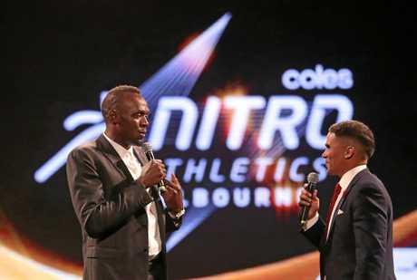 Usain Bolt speaks with John Steffensen on stage during the Nitro Athletics Gala Dinner at Crown Palladium in Melbourne