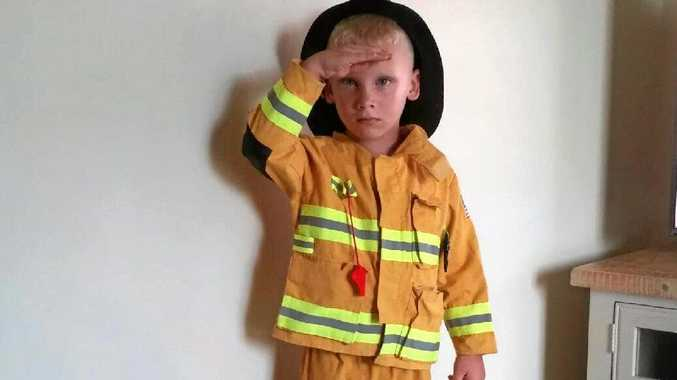 Sippy Downs boy George Lloyd got his firefighting costume on when a bushfire threatened homes in his neighbourhood.