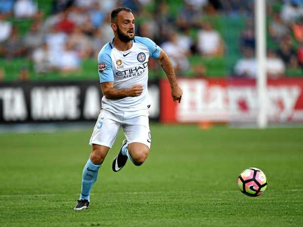 Melbourne City player Ivan Franjic controls the ball.