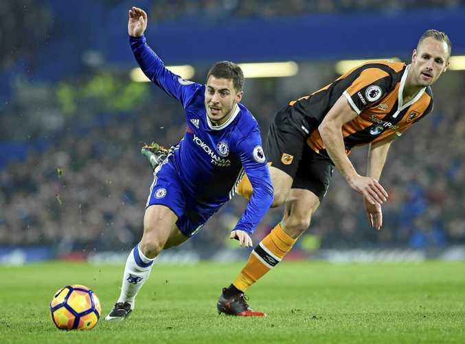 Chelsea's Eden Hazard (left) vies for the ball with Hull City's David Myler.