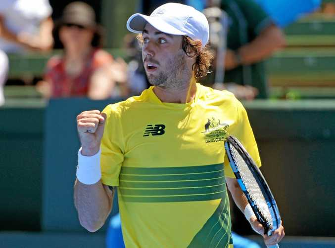 Jordan Thompson of Australia reacts after winning a point against Jiri Vesely of the Czech Republic in their Davis Cup clash.