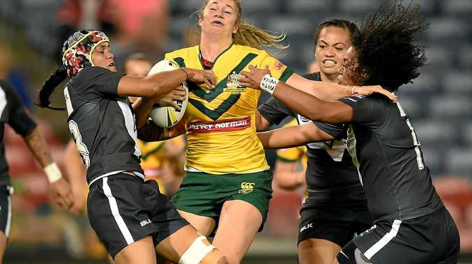 Kezie Apps of the Jillaroos is tackled by Nora Maaka (left) and Teuila Fotu-Moala of the Kiwi Ferns during last year's trans-Tasman Test.