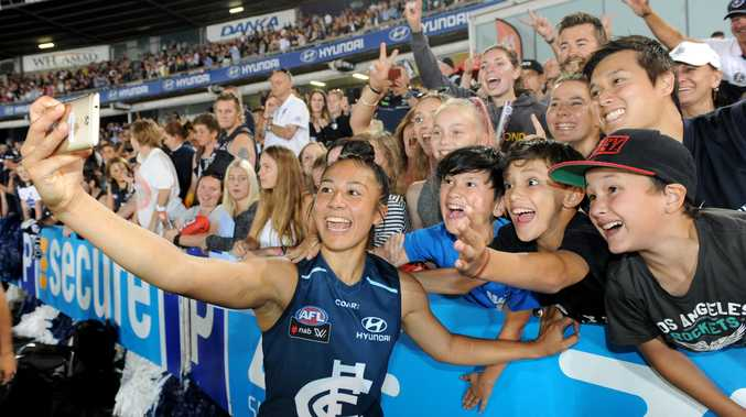 Darcy Vescio of Carlton celebrates with fans after the round 1 AFLW match between the Carlton Blues and the Collingwood Magpies at Ikon Park in Melbourne, Friday, Feb. 3, 2017. (AAP Image/Joe Castro)