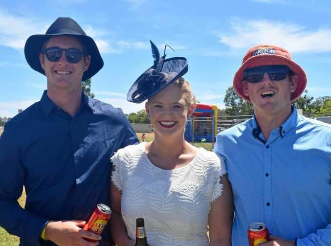 Matt Wassell, Trish Carroll and Allan Davis enjoy the last race track side.