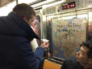 WIN: Vandal draws swastikas on train, unites people