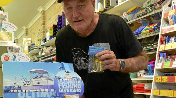 Yamba angler Tony Carr grabs his Daily Examiner and fishing lures at the Yamba Newsagency on Saturday.