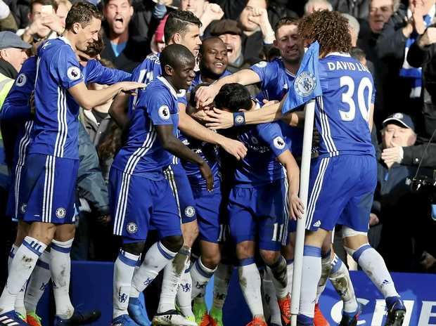 Chelsea's Eden Hazard, is mobbed by his teammates after scoring his side's second goal against Arsenal.