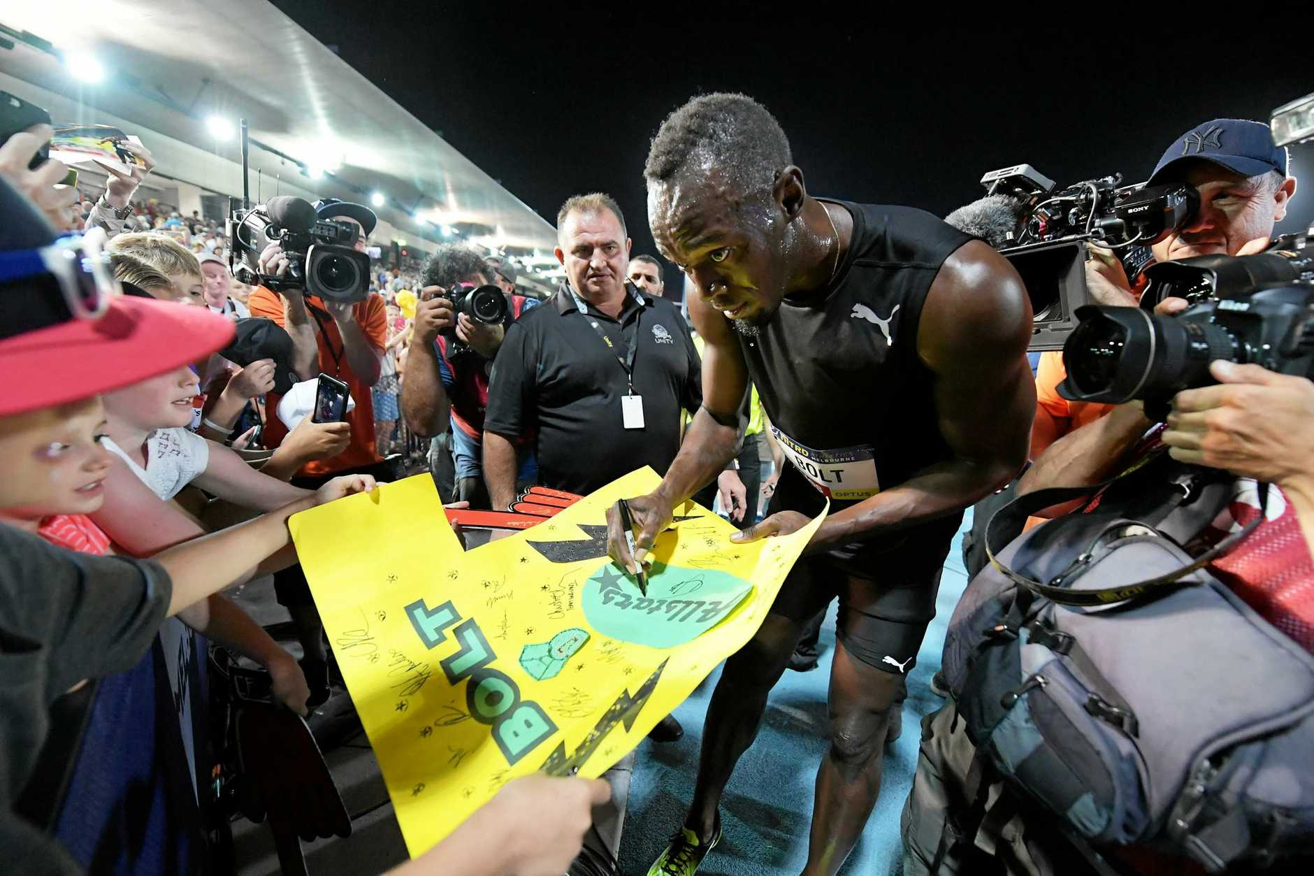 Usain Bolt signs autographs for fans  at Lakeside Stadium in Melbourne