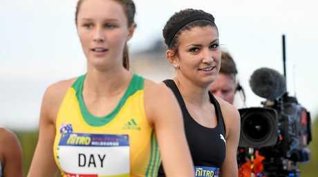 Riley Day congratulates Zoe Hobbs of New Zealand following the Women's 150m