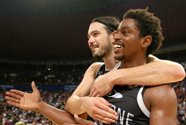 Chris Goulding and Casper Ware of Melbourne United celebrate victory over the Sydney Kings at Qudos Bank Arena